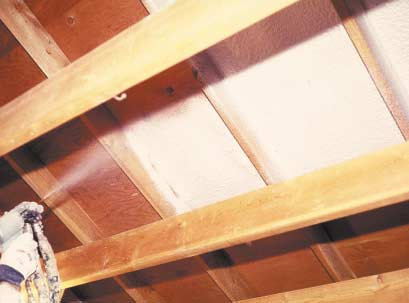 Low-density polyurethane foam sprayed in between floor joists serves triple duty as insulation, air barrier, and sound control device.