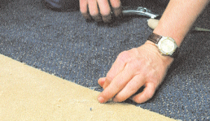 All carpet breadths are then aligned to the proper position and the seams trimmed before adhesive is applied. Once the adhesive has been spread for a given section, the carpet is laid into it according to the manufacturer's suggested open time to allow even distribution and penetration of all backing areas. Rolling should be performed with the lightest roller possible that achieves a satisfactory transfer of adhesive into the carpet backing. To ensure all the hard work pays off, traffic should be kept from the newly carpeted area for a minimum 24 to 48 hours after installation.