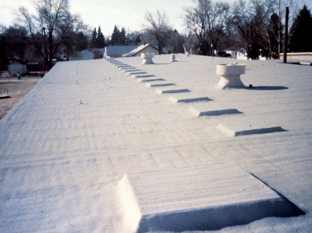 Spray foam roofing protects in high winds because of its high adhesion and tensile strength.