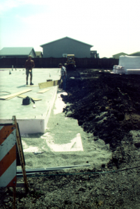 "Figure 4: FPSF foundation under construction in Fargo, ND, showing vertical-slab edge insulation plus horizontal ""wing"" insulation required for very cold climates."